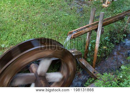 Water wheel powered by water stream producing energy
