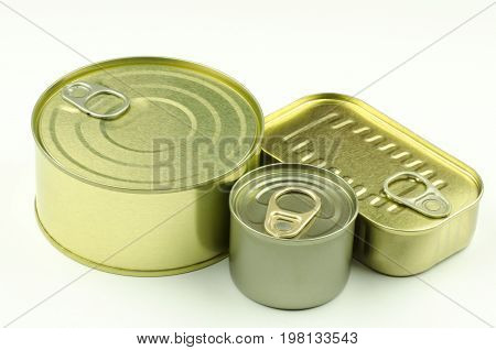 Close-up view of various tins and cans on white background