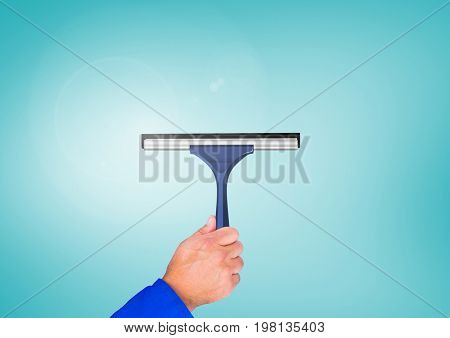 Digital composite of Hand holding window cleaner