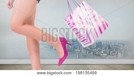 Digital composite of WOmens legs with shopping bag over city
