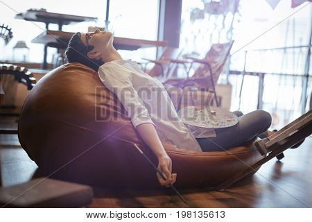 Tried overworked female artist sleeping while working