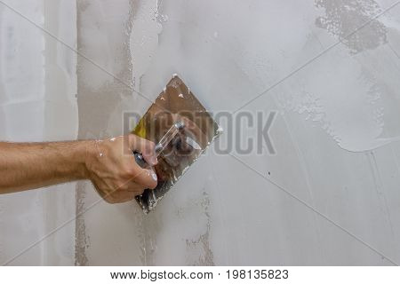 Man Hand With Trowel Plastering A Wall 3