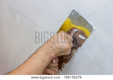 Man Hand With Trowel Plastering A Wall 4
