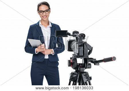 Smiling Female Newscaster With Digital Tablet Standing In Front Of Camera, Isolated On White