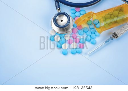 Health care concept. Composition with pills and medical stuff on blue background