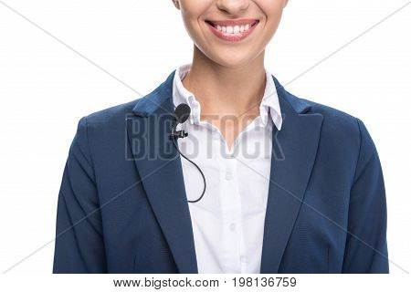 Cropped View Of Smiling Female Newscaster With Tie Clip Microphone