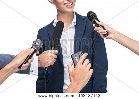 Cropped View Of Journalists With Microphones And Recorder Interviewing Smiling Businesswoman, Isolat