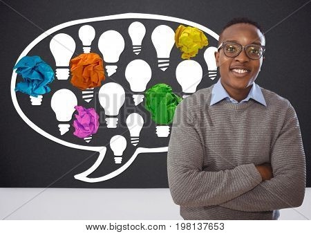 Digital composite of Man standing next to light bulbs chat bubble with crumpled paper balls in front of blackboard