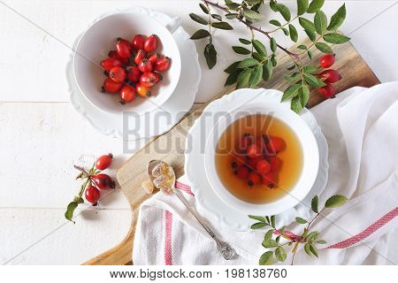 Rose hip tea and berries healthy extract. Top view