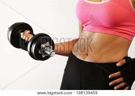 Woman lifting dumbbell with her right arm.