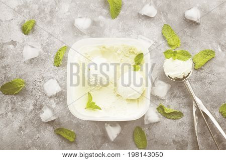 Mint Ice Cream In Bowl And Spoon For Ice Cream On A Gray Background. Top View. Food Background. Toni