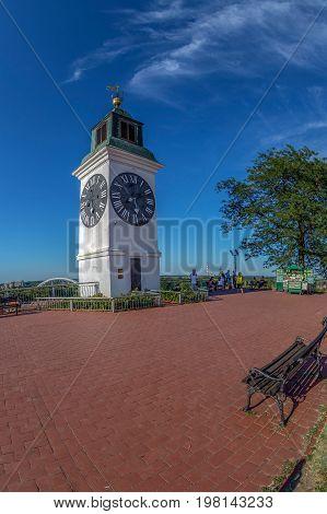 NOVI SAD SERBIA - JULY 30 2017: The clock tower one of Novi Sad's major landmarks. The short the forefinger shows minutes and the long forefinger shows hours.