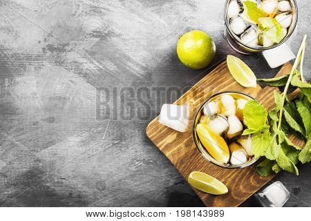 Two Glasses Of Cocktail Cuba Libre On A Dark Background. Top View, Copy Space. Food Background