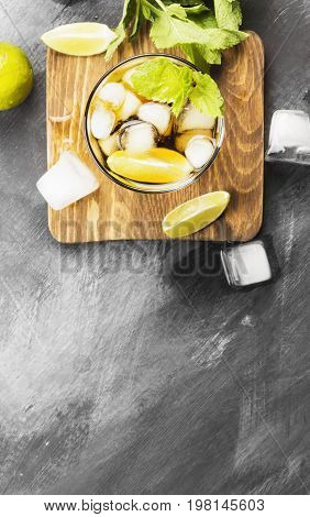 Cocktail Cuba Libre In A Glass On A Dark Background. Top View, Copy Space. Food Background