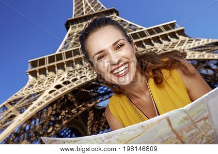 Happy Woman With Map Against Eiffel Tower, Paris
