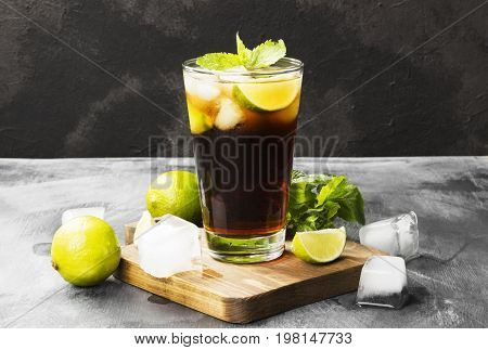 Cocktail Cuba Libre In A Glass On A Dark Background. Copy Space. Food Background