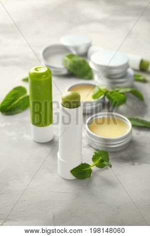 Cosmetic products with lemon balm on table
