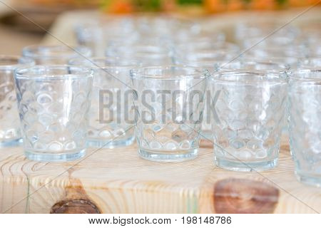 Empty glasses are on the table. white cloth