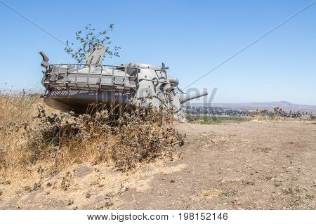Memorial to the 1973 Yom Kippur War on the Golan Heights. The destroyed tower of the Israeli tank dug into the ground in the direction of Syria.