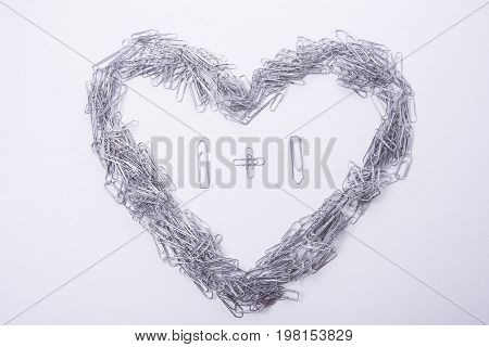 Heart make from paper clips on the white background
