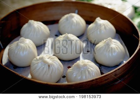 Xiaolongbao traditional soup dumpling is a popular chinese dim sum steamed bamboo steamers XiaoLongBao chinese food in Shanghai