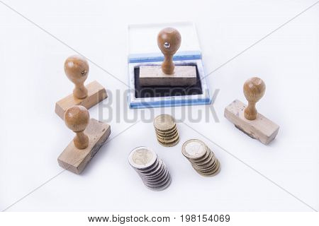 Old rubber stamp with the pad and euro coins