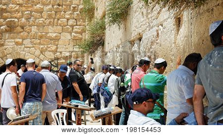 Jerusalem, Israel - May 25, 2017: Western Wall or Wailing Wall or Kotel in Jerusalem. People come to pray to the Jerusalem western wall. The Wall is the most sacred place for all jews in the world.
