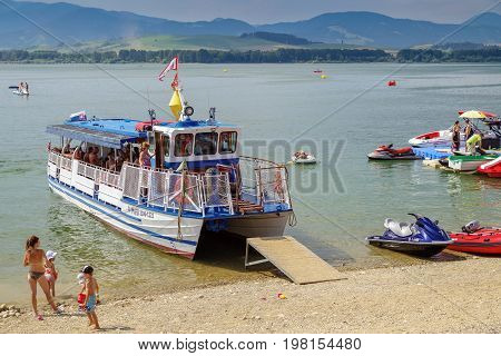 LiPTOVSKY TRNOVEC SLOVAKIA - AUGUST 2: Sightseeing tour boat on lake Liptovska Mara on August 2 2017 in Liptovsky Trnovec