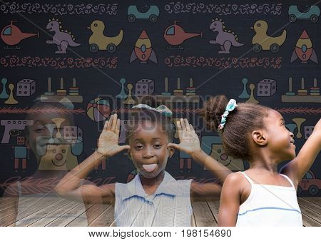 Digital composite of Girl transition effect fading with blackboard background and toys graphics