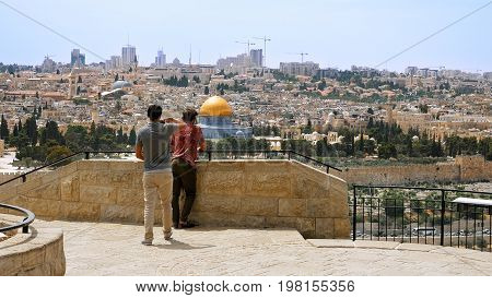 Jerusalem, Israel - May 25, 2017: Tourist takes a photo and selfie against Jerusalem Old City view. Mount of Olives is a famous Holy Land place and it has a fantastic view to the Old Jerusalem