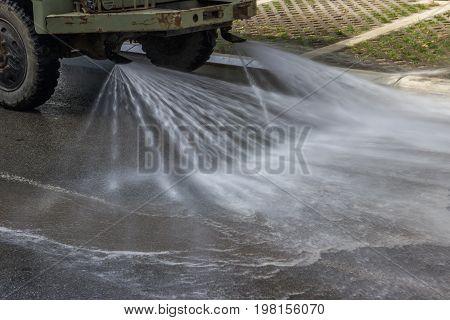 Street Flusher In Action