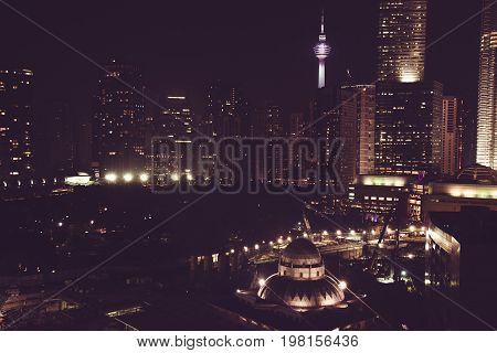 Spectacular night city view. Kuala Lumpur skyscrapers, Malaysia. Business metropolis. Modern buildings. Luxurious travel and tourism. Urban cityscape. Metropolitan architecture. High rise offices