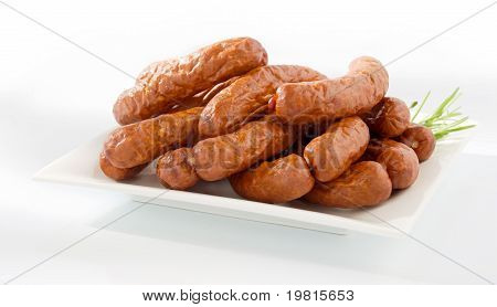 Fresh peasant sausage on a plate isolated on white background poster
