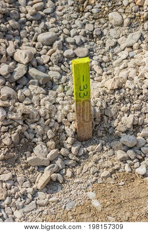 Wood Stake With Survey Markings And Yellow Tag
