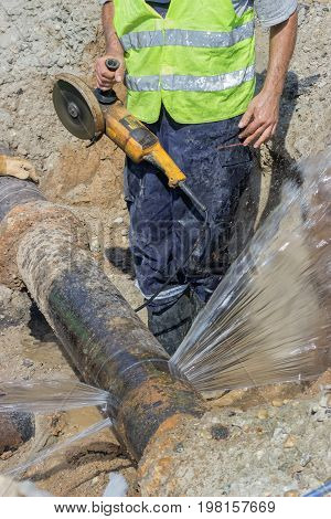 Worker Cut Section Of Water Main Pipe 2