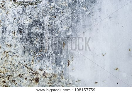 Scratched and rusted old metal background. Peeling paint and corrosion on grey metal. Grunge texture