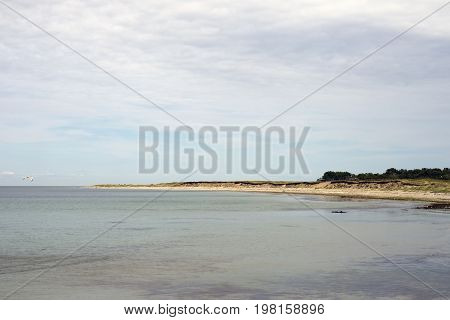 View from sanddune at Bloeden Hale over the beach and sea Laesoe Island in Kattegat sea Denmark.