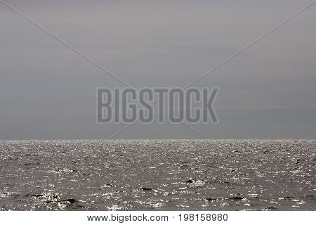 The glimmer of sunshine over sea Laesoe Island in Kattegat sea Denmark.