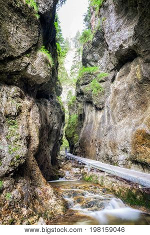 Empty footbridge water stream and rocky canyon in Janosikove diery - tourist attraction in nation park Mala Fatra Slovakia