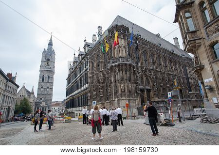 Ghent Belgium - June 26 2011: Tourists visit town hall of Ghent