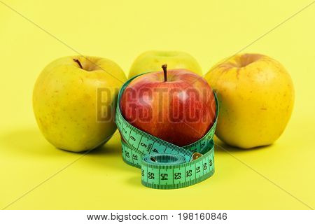 Apples And Tape For Measuring In Greenish Blue Color
