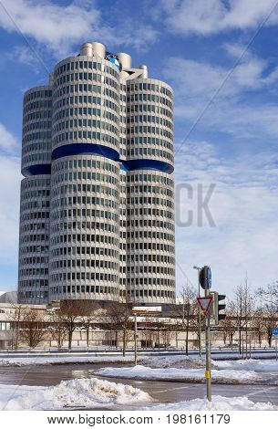 MUNICH, GERMANY - JANUARY 2: BMW Headquarters on January 2, 2015. The four vertical cylinders building is a Munich landmark which is world headquarters for the Bavarian automaker.