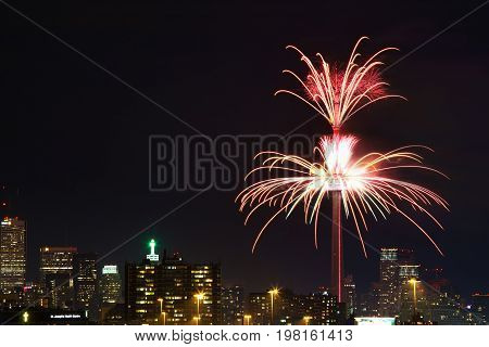 TORONTO - JULY 01, 2017:Fireworks set off from famous  CN tower light up Toronto sky to mark Canada's 150th anniversary. CN Tower is a global cultural icon of Canada and one of the most recognizable structures in the world.