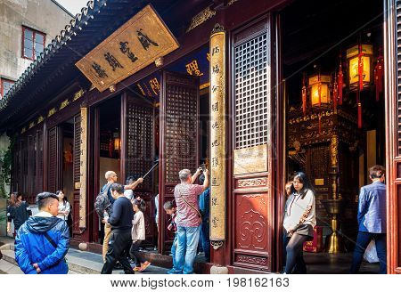 Shanghai, China - Nov 6, 2016: Inner courtyard of the 600-year-old Old City God Temple, where the Hall of City God altar resides. The surrounding is bustling with visitors.