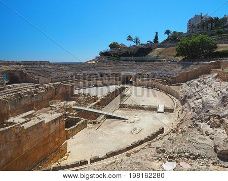 Roman amphitheater against a clear blue sky  in  Tarragona,  Catalonia, Spain