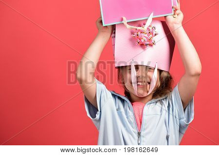 Kid With Happy Smiling Face And Messy Hairdo Does Shopping