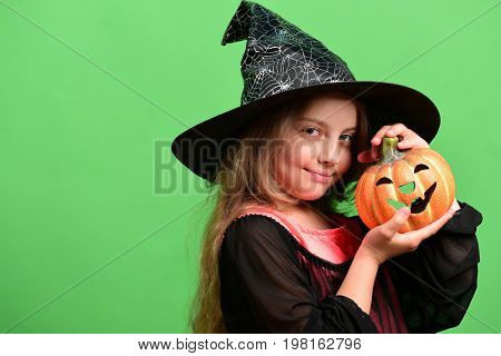 Halloween And Celebration Concept. Child In Witch Costume