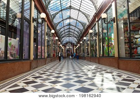 PARIS, FRANCE - June 14, 2017: Interior of Passage des Princes built in 1860 between Boulevard des Italiens and Rue de Richelieu. French Antique life.