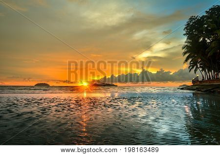 The beautiful sunset on the beach at low tide & reflections in the sand.