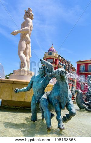 NICE, FRANCE - JULY 4, 2017: A view of the fountain Fontaine du Soleil at the Place Massena square in Nice, France. The Place Massena is the main public square in the famous city of the French Riviera